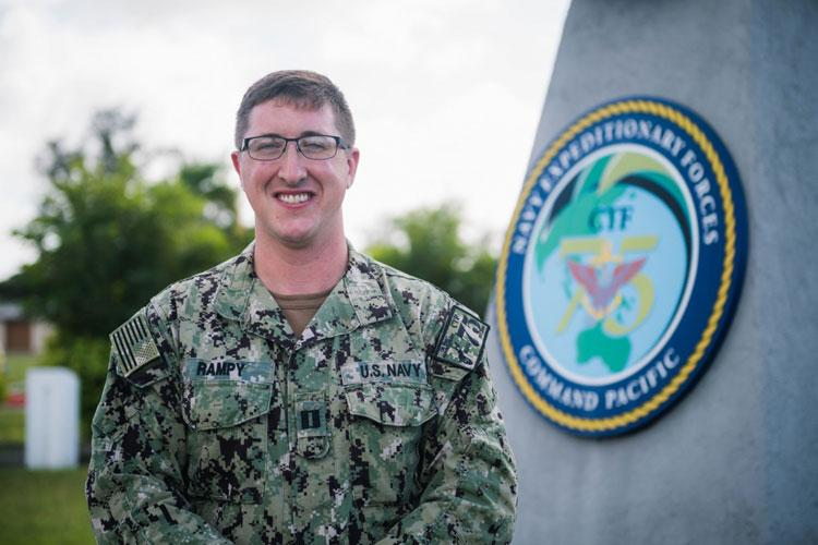 SANTA RITA, Guam (Jan. 4, 2021) Lt. Neil Rampy, the senior medical officer and psychological health team lead clinician for Navy Expeditionary Forces Command Pacific-Task Force 75, poses for a photo in front of the headquarter building on Camp Covington in Santa Rita, Guam. Rampy was named Navy Medicine's Clinical Social Work Officer of the Year for 2020. (U.S. Navy photo by Mass Communication Specialist 2nd Class Cole C. Pielop)