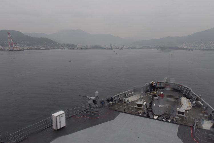 KURE, Japan (Jan. 22, 2020) - The submarine tender USS Emory S. Land (AS 39), prepares to moor in Kure, Japan, Jan. 22, for a scheduled port visit. Land is deployed to the U.S. 7th Fleet area of operations to support theater security cooperation efforts in the Asia-Pacific region. (Photo by Mass Communication Specialist 1st Class Jason Behnke)