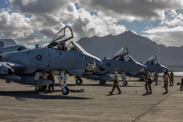 U.S. Airmen assigned to the 442nd Fighter Wing from Whiteman Air Force Base, Missouri, secure A-10 Thunderbolt II aircraft after arriving at Marine Corps Air Station Kaneohe Bay, Marine Corps Base Hawaii, Feb. 11, 2019. The unit participated in a training exercises with joint terminal air controllers, B-52H Stratofortress bombers, along with U.S. Marine Corps AH-1Z helicopters and U.S. Army forward observers on Hawaii. (U.S. Marine Corps photo by Sgt. Jesus Sepulveda Torres)