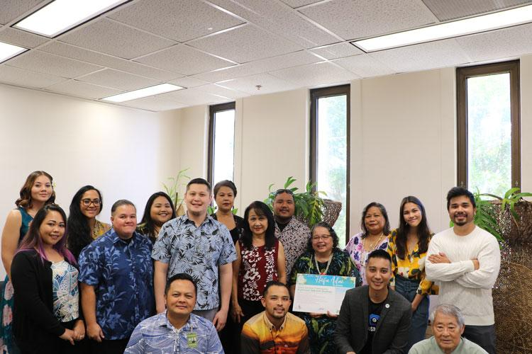 Guam Visitors Bureau's Public Information Officer Josh Tyquiengco and Director of Tourism Research Nico Fujikawa welcomed the Guam Election Commission team as new members of the Håfa Adai Pledge program on May 16, 2019 at the election commission's office in Hågatña.