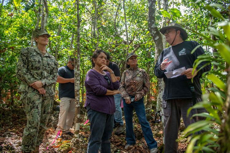 ANDERSEN AIR FORCE BASE, Guam (June 3, 2019) - Jim McConnell, Serianthes nelsonii principal investigator, Guam Plant Extinction Prevention Program, describes the Serianthes nelsonii tree to Rear Adm. Shoshana Chatfield, commander, Joint Region Marianas, left, and Guam Gov. Lou Leon Guerrero, center, during a visit to the tree at Andersen Air Force Base June 3. (U.S. Navy photo by Alana Chargualaf)