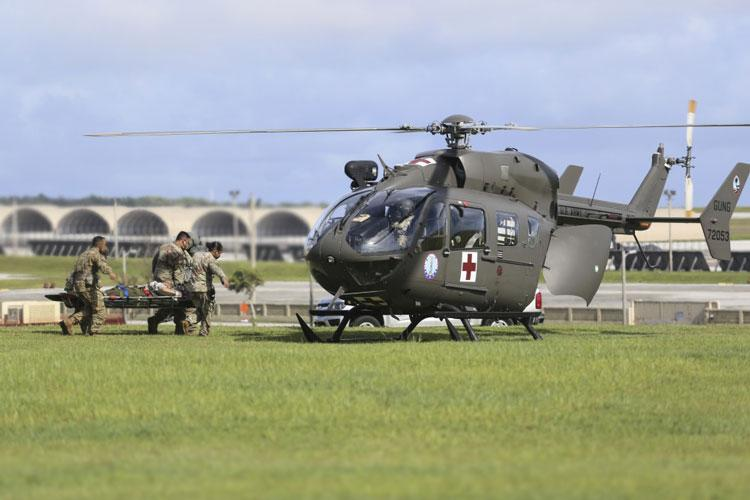 Soldiers from the Guam National Guard load a medical evacuation patient into a GUNG Lakota helicopter at Andersen Air Force Base on June 30. (Photo By Capt. Mark Scott)