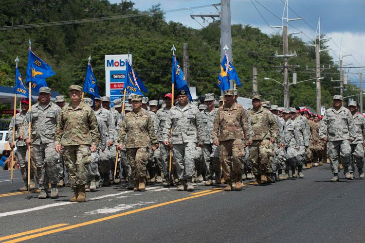 Team Andersen Airmen participate in the 75th Annual Guam Liberation Day Parade July 21, 2019 in Hagatna, Guam. The 75th commemoration of the Marines landing on Guam included special observances, food, music, dancing and a parade down Marine Corps drive featuring record breaking attendance with more than 70 floats and marching units. (U.S. Air Force photo by Airman 1st Class Amir R. Young)