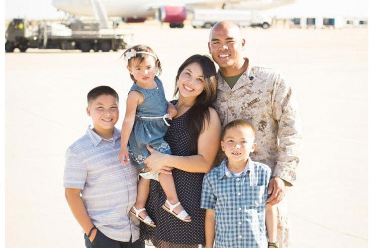 Staff Sgt. Fructuoso Santos poses with his childhood friend and wife, Tiana, and their three children at Marine Corps Air Station Miramar, California.