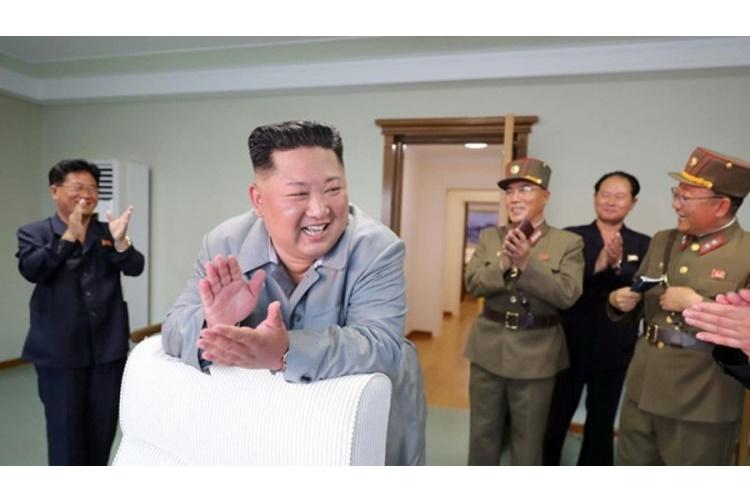 North Korean leader Kim Jong Un celebrates in this undated photo released by the Korean Central News Agency, Friday, July 26, 2019. (KCNA)