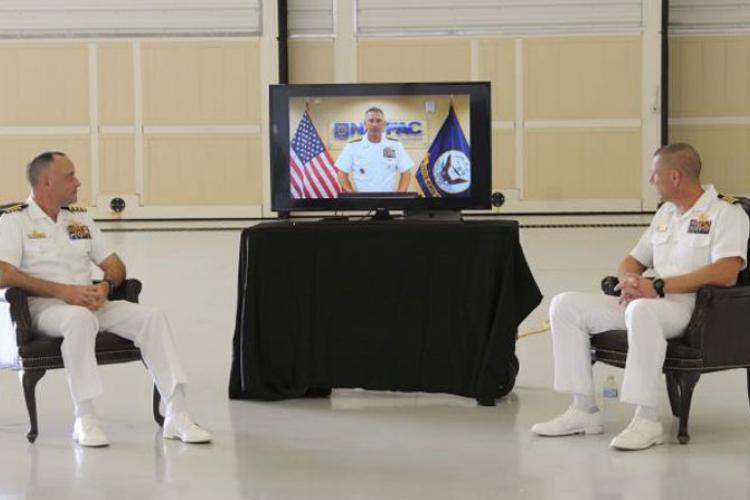 ANDERSEN AIR FORCE BASE (Aug. 21, 2020) - Rear Adm. John Adametz, Naval Facilities Engineering Command Pacific commander, delivers remarks virtually during the Officer in Charge of Construction Marine Corps Marianas change of command ceremony at Andersen Air Force Base Aug. 21. During the ceremony, Capt. Steven Stasick, right, relieved Capt. Joseph Greeson as commanding officer. (U.S. Navy photo by JoAnna Delfin)