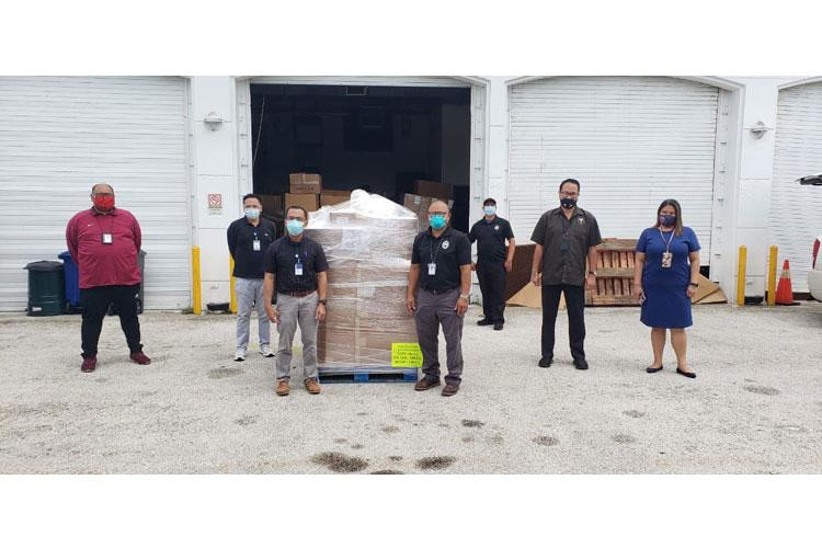 Representatives from the Guam Memorial Hospital, Department of Public Health and Social Services, Guam Fire Department, and Guam Regional Medical City pictured receiving a donation of Powered Air Purifying Respirators (PAPR) from the Federal Emergency Management Agency (FEMA) and Health and Human Services (HHS) to support the ongoing response to COVID-19.