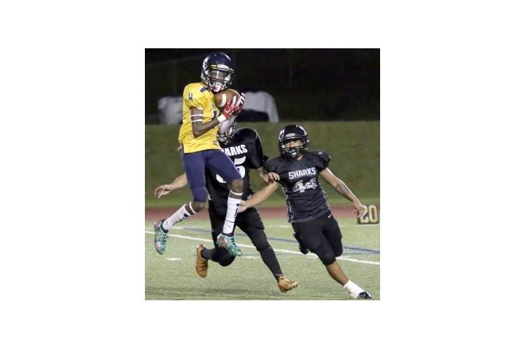 """Guam High receiver A.J. Johnson goes up for one of his six catches for 120 yards in what coach Jacob Dowdell called his """"breakout"""" game of the season. (DONNA RHODES/SPECIAL TO STRIPES)"""