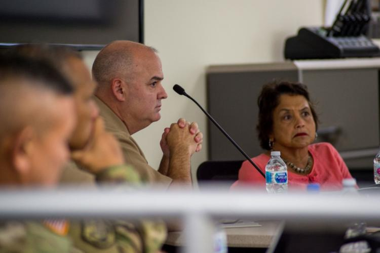 SANTA RITA, Guam (Oct. 22, 2019) - Capt. Tim Poe, Commander, Submarine Squadron Fifteen, and Guam Gov. Lourdes Leon Guerrero attend a scheduled brief at CSS-15. The brief was conducted as part of the Navy's continuing program to coordinate with civil authorities and improve understanding of the Navy's mission, operation, and crew training. CSS-15 is located at Polaris Point, Naval Base Guam, and consists of four forward-deployed Los Angeles-class fast attack submarines. (MC2 Kelsey J. Hockenberger)