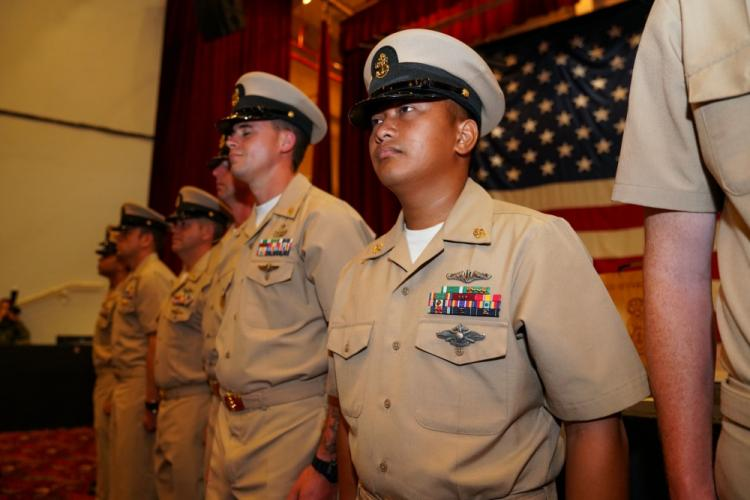 NAVAL BASE GUAM, Guam (Sept. 13, 2019) Newly pinned U.S. Navy chief petty officers from multiple Guam based commands stand in formation during a CPO pinning ceremony onboard Naval Base Guam. The ceremony consisted of a total of 29 Sailors and one Airman promoted to the paygrade of CPO with a total of 46 CPOs island wide. (U.S. Navy photo by Mass Communication 2nd Class Kelsey J. Hockenberger)