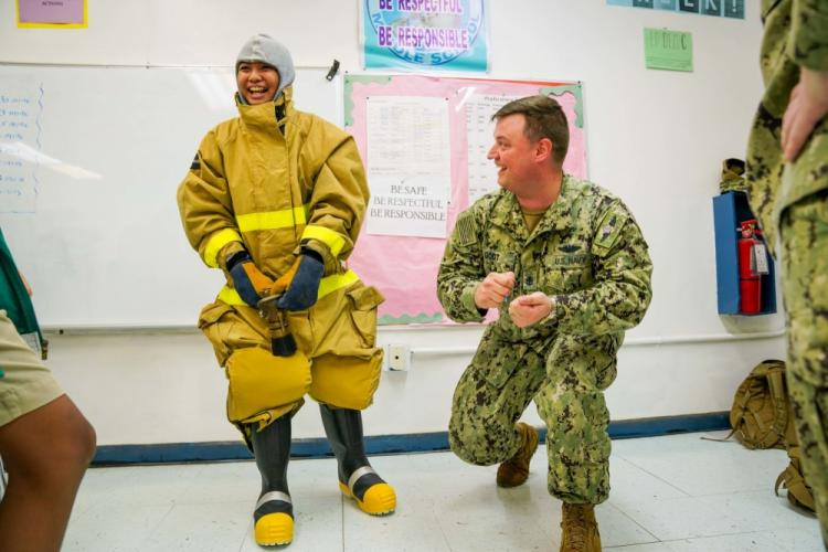 PITI, Guam (Jan. 30, 2020) - Chief Machinists Mate (Nuclear) Christopher Godt, assigned to Commander, Submarine Squadron Fifteen (CSS-15), demonstrates proper firefighting techniques during a career day at Jose L. G. Rios Middle School. CSS-15 is responsible for providing training, material, and personnel readiness support to four Los Angeles-class fast attack submarine commands located at Polaris Point, Naval Base Guam. (U.S. Navy photo by Mass Communication Specialist 2nd Class Kelsey J. Hockenberger)