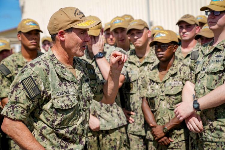 """SANTA RITA, Guam (Feb. 7, 2020) Rear Adm. Blake Converse, Commander of Submarine Force, U.S. Pacific Fleet, delivers remarks to Sailors assigned to the Los Angeles-class fast attack submarine USS Oklahoma City (SSN 723) after presenting the Battle """"E"""" Award on the pier at Apra Harbor, Guam. Oklahoma City is one of four forward-deployed submarines assigned to Commander, Submarine Squadron Fifteen out of Apra Harbor, Guam. (U.S. Navy photo by Mass Communication Specialist 2nd Class Kelsey J. Hockenberger)"""