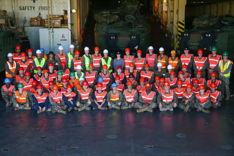 U.S. Marines with 3rd Marine Logistics Group and Sailors with the USNS Dahl (T-AKR-312), pose for a group photo at the completion of a Maritime Prepositioning Force exercise at U.S. Naval Base Guam, Feb. 29, 2020. Marines with 3rd MLG exercise their MPF capabilities by validating Mission Essential Tasks to enhance operational readiness and increase their ability to support the III Marine Expeditionary Force. (U.S. Marine Corps photo by Cpl. Ryan Harvey)