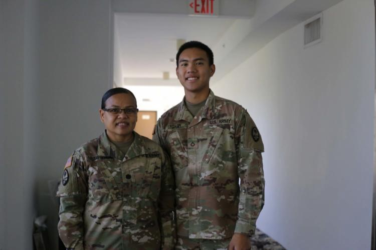 TAMUNING, Guam (June 8, 2020) – Lt. Col. Marlene Tarusan-Legaspi and her son Pfc. Nikolas Legaspi, both with the Guam Army National Guard, find time during their COVID-19 missions to spend a moment together in Tamuning, Guam June 8. Tarusan-Legaspi and her son were activated to support the government of Guam's response to the COVID-19 pandemic. (U.S. Army National Guard photo by JoAnna Delfin)
