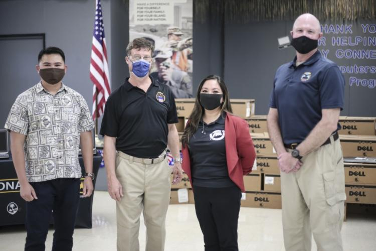 From left, Plamin Rabino of the Guam National Guard, Edward Fobes of the The Defense Logistics Agency, Erica Cepeda, school principal, and Eric Mills of DLA, donate 50 computers to Merizo Elementary on Aug. 14, as part of the DLA's Computers for Learning Program. Intended to streamline the transfer of excess Department of Defense IT equipment to schools, The Guard and DLA are set to expand the CFL program to other schools around the island.