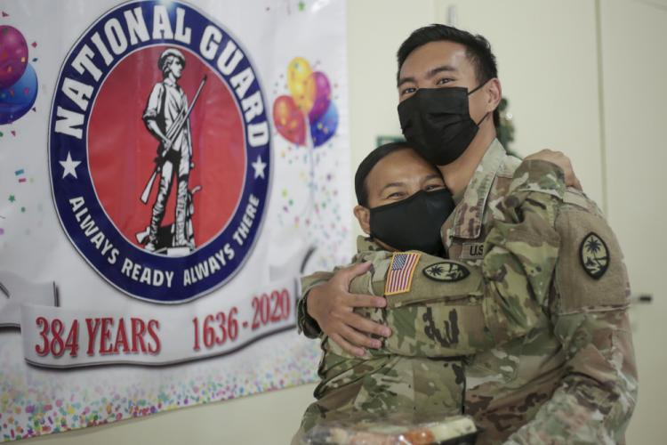 Lt. Col. Marleen Tarusan-Legaspi, left, and her son Pfc. Nikolas Legaspi, celebrate the National Guard's 384th birthday at a holiday meal grab-and-go event at the Guam National Guard's Barrigada Readiness Complex on Dec. 13.