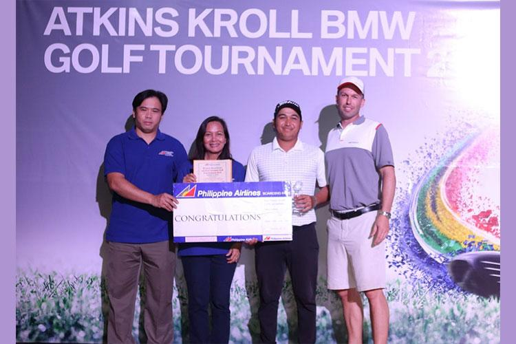 Standing left to right – Jose Fajardo, Operations Manager, Goodwind Travel & Tour, Connie Morale-Mayers, Sales Manager, Goodwind Travel & Tour, Nalapon Vongjalorn, winner, and Alex Hammett, President, Atkins Kroll BMW