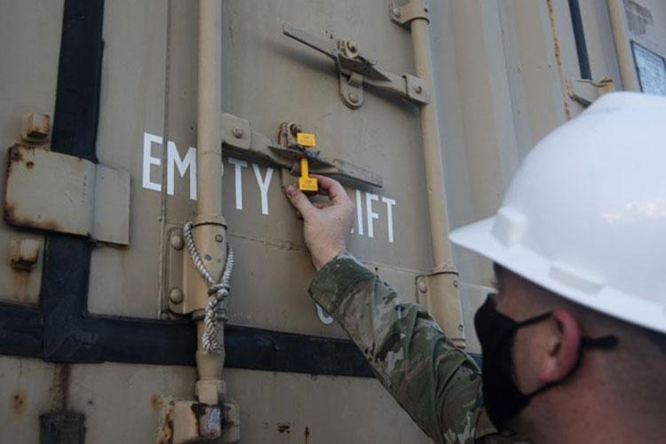 U.S. Air Force Staff Sgt. Adam Doutrich, a stockpiler supervisor assigned to the 36th Munitions Squadron, inspects a seal on a storage container at Naval Base Guam, Nov. 15, 2020. The Navy and the Air Force continue to develop and maintain operational compatibility by completing munition transport operations while also ensuring combat readiness to both forces. (U.S. Air Force photo by Senior Airman Michael S. Murphy)