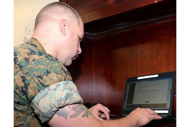 Gunnery Sgt. Tyler Nichols registers to vote during the Marine Corps Logistics Base Albany, Ga.'s first voting convention in 2017. Marines can encourage others to vote, but they remain restricted both in person and online when it comes to advocating for political candidates. (NATHAN HANKS/U.S. MARINE CORPS)