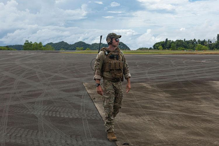 U.S. Air Force Senior Airman Jonathan Gilbreath, a fire team member assigned to the 736th Security Forces Squadron, creates a security perimeter around a C-130J Hercules assigned to the 36th Airlift Squadron, Yokota Air Base, Japan, at Palau International Airport, Palau, during a Dynamic Force Employment Nov. 23, 2020. (U.S. Air Force photo by Senior Airman Michael S. Murphy)