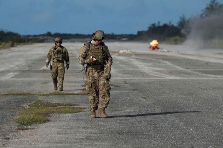 Andersen explosive ordinance disposal team performs clearance operations after a simulate attack , as part of a rapid airfield damage repair exercise, March 7, 2019, on Andersen Air Force Base, Guam. This exercise marked the first time that a full scale airfield assessment, clearance and repair took place in the same exercise. (U.S. Air Force photo by Senior Airman Zachary Bumpus)