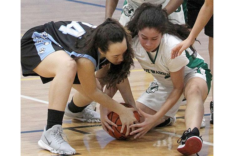 Osan's Thalia Cowden and Jaela Sahegan of last year's runner-up Daegu hope to bring a Division II girls basketball tournament title banner to Korea since the Warriors won it in 2014. JESSICA MCCOLLUM/SPECIAL TO STRIPES