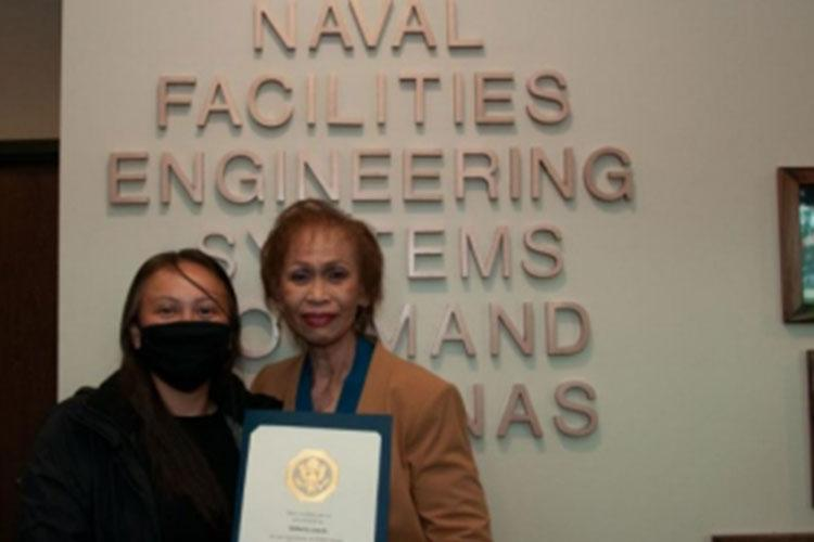 Mildred Camacho, Naval Facilities Engineering Systems Command (NAVFAC) Marianas financial management analyst, right, and her daughter Karianne Camacho, NAVFAC Marianas real estate business line leader, have their photo taken after a command awards ceremony in Asan, Guam. During the ceremony, Mildred Camacho celebrated 50 years of civil service.