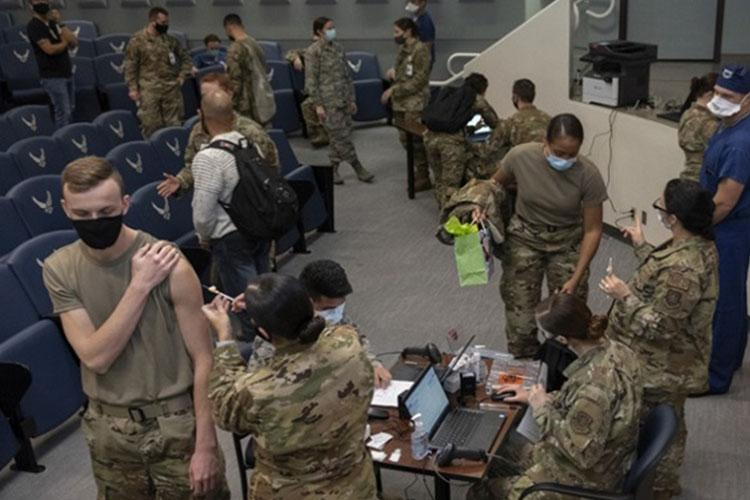 Airmen from the 60th Surgical Operations Squadron, 60th Inpatient Squadron, 60th Healthcare Operations Squadron and 60th Operational Medical Readiness Squadron are cleared through a three-step process to receive the COVID-19 vaccine Dec. 22, 2020, at Travis Air Force Base, California. The Airmen were among the first to receive the vaccine at David Grant U.S. Air Force Medical Center, the Air Force's largest medical facility (Photo by: Air Force Senior Airman Cameron Otte).