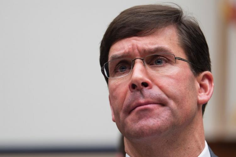 Defense Secretary Mark Esper attends a hearing on Capitol Hill in Washington on Feb. 26, 2020. At the Pentagon Thursday, March 12, Esper said six American service members and seven military dependents have confirmed cases of the coronavirus.