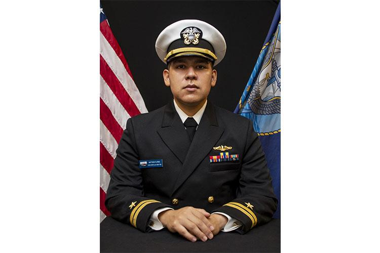 SANTA RITA, GUAM (Nov. 30, 2020) - Lt. Matthew Flores, assigned to the Los Angeles-class fast attack submarine USS Asheville (SSN 758), poses for an official photo at Konetzni Hall, Nov. 30. (U.S. Navy photo by Mass Communication Specialist 2nd Class Kelsey Hockenberger)
