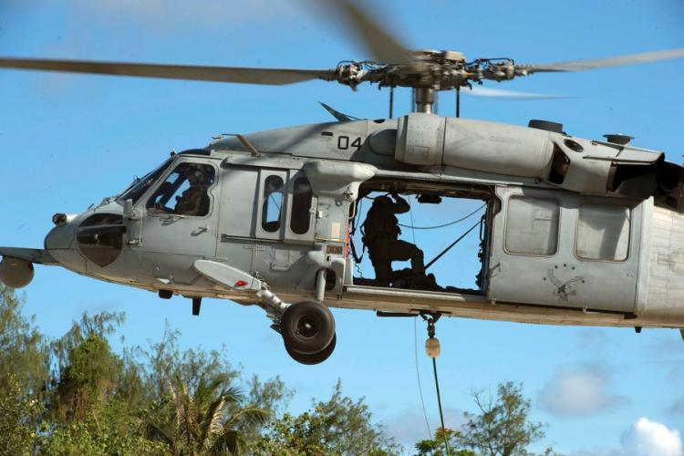 An MH-60S Seahawk from Helicopter Sea Combat Squadron 25 takes part in a torpedo recovery exercise in Polaris Point, Guam, Oct. 16, 2019. HEATHER WAMSLEY/U.S. NAVY