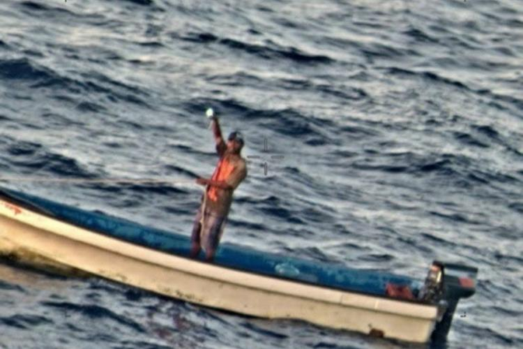 A fisherman stranded for five days in the Pacific Ocean signals to the crew of a Navy P-8A Poseidon about 600 nautical miles from Guam, Friday, Jan. 17, 2020. U.S. NAVY