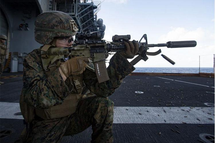 U.S. Marine Corps Lance Cpl. Claudia Murphy, a mortarman with Battalion Landing Team 3/5, 31st Marine Expeditionary Unit (MEU), conducts a deck shoot aboard amphibious assault ship USS America (LHA 6), in the Pacific Ocean, July 14, 2021. The deck shoot consisted of Marines practicing a series of shooting drills to maintain weapons proficiency. The 31st MEU is operating aboard ships of the America Expeditionary Strike Group in the 7th fleet area of operations to enhance interoperability with allies and part