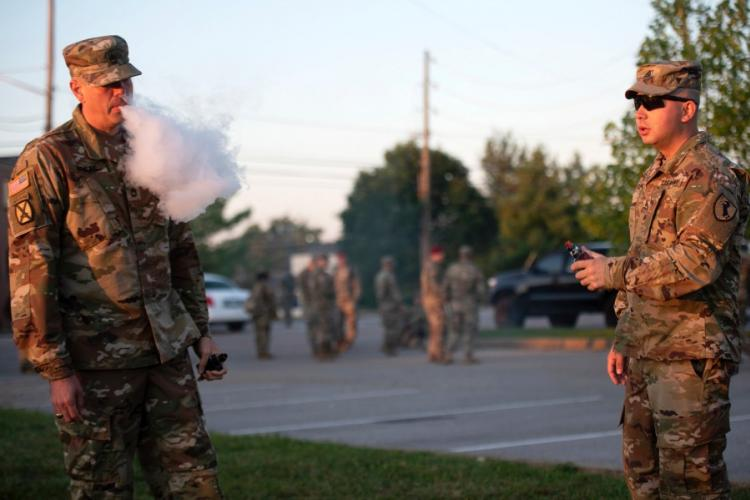 Sgt. 1st Class Bryson Briles, left, and Staff Sgt. Jorge Flechas enjoy a relaxing moment vaping before heading to class at U.S. Army Recruiting and Retention College Sept. 5, 2019. Briles said he vapes as a safer alternative to cigarettes. Flechas said he vapes for recreational purposes. Health officials say they suspect the more than 200 recent deaths and serious illnesses across a 25-state area in the United States are the result of vaping. ERIC PILGRIM/U.S. ARMY