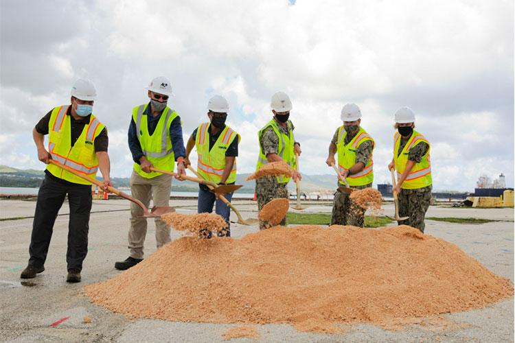 SANTA RITA, Guam (April 28, 2021) -Naval Facilities Engineering Systems Command (NAVFAC) Marianas, U.S. Naval Base Guam (NBG), Military Sealift Command Ship Support Unit Guam, and H20 Guam Joint-Venture (JV) representatives break ground for repairs to Lima Wharf aboard NBG April 28. NAVFAC Marianas awarded a $98 million contract to H20 Guam JV in January for the modernization and restoration of the wharf with project completion expected by November 2023. (U.S. Navy photo by JoAnna Delfin)