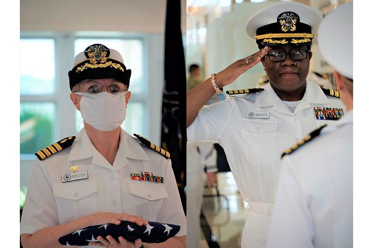 AGANA HEIGHTS, Guam (June 23, 2020) - (Left) Capt. Maria Young, commanding officer, U.S. Naval Hospital Guam holds the American flag at her retirement ceremony on June 23, 2020. (Right) Capt. Thecly H. Scott reports as commanding officer, U.S. Naval Hospital Guam during a change of command ceremony on June 23, 2020. (U.S. Navy Photo by HM3 Richard Brown, U.S. Naval Hospital Guam Public Affairs)