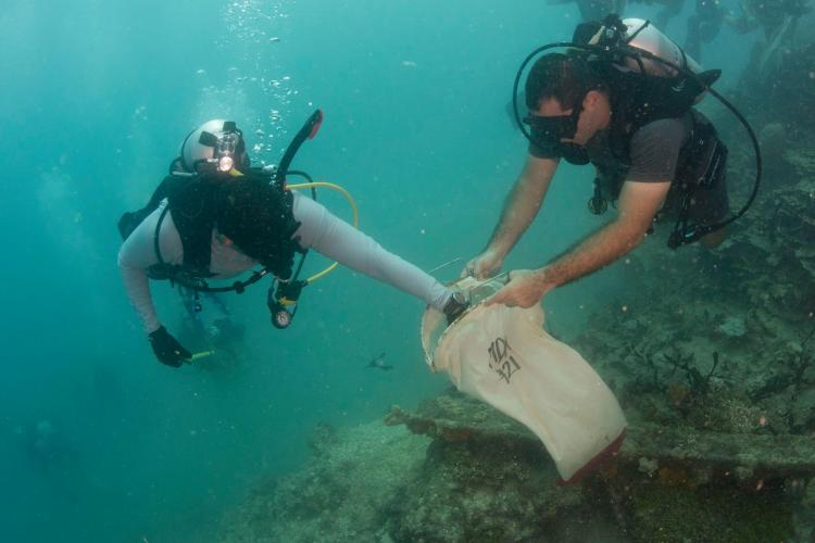 AGAT, Guam (March 14, 2018) – Sailors assigned to Naval Airborne Weapons Maintenance Unit 1 participate in a dive cleanup in waters off a cemetery in  Agat March 14, 2018. The cleanup yielded 17 bags of debris. (Photo courtesy of Naval Airborne Weapons Maintenance Unit 1)