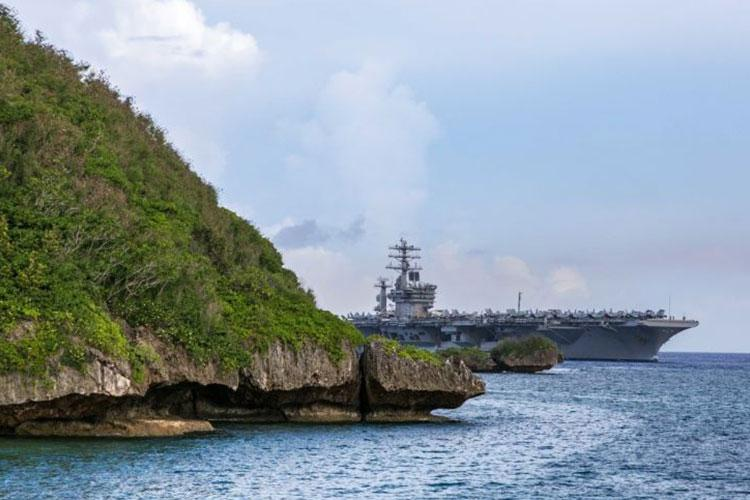 SANTA RITA, Guam (June 24, 2020) - The aircraft carrier USS Nimitz (CVN 68) passes Point Udall as it enters Apra Harbor prior to mooring at Naval Base Guam for a scheduled port visit. Nimitz, the flagship of Carrier Strike Group 11, is deployed conducting maritime security operations and theater cooperation efforts. (U. S. Navy photo by Chief Mass Communication Specialist Matthew R. White)