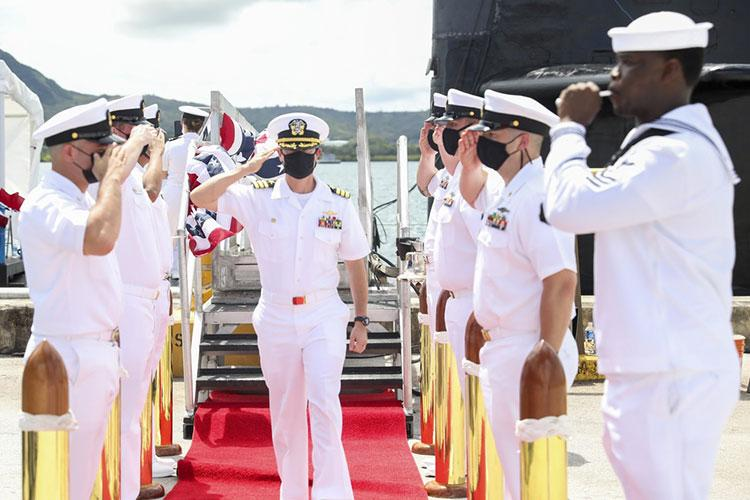NAVAL BASE GUAM (Sept. 3, 2021) Cmdr. Sean Welch, from Colonie, New York, passes through side boys during a change of command ceremony for the Los Angeles-class fast-attack submarine USS Oklahoma City (SSN 723), Sept. 3. Welch relieved Cmdr. Steven Lawrence, from Bridgeport, Pennsylvania, as Oklahoma City's commanding officer during a ceremony held aboard the submarine. (U.S. Navy photo by Mass Communication Specialist 1st Class Jordyn Diomede)