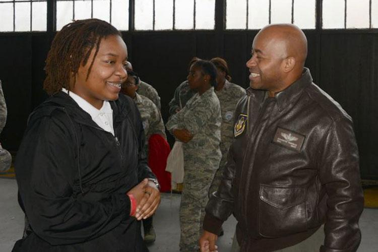 Praise Wright, speaks with Maj. Kenneth Thomas, a navigator with the 94th Airlift Wing, Dobbins Air Reserve Base, Ga. during an Air Force Recruiting Service Detachment 1 Aim High event, Nov. 19, 2019, at Maxwell Air Force Base, Ala. Det. 1 is celebrating two years of addressing rated diversity in the Air Force. Since its inception in October 2018, Det. 1 has conducted 165 events with more than 355,000 attendees, directly mentoring more than 39,000 youth. (U.S. Air Force photo by Master Sgt. Chance Babin)