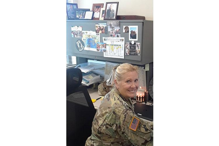 Lt. Col. Jayne Strathe, Deputy Surgeon for the 9th Mission Support Command, headquartered in Honolulu, Hawaii, saves the life of a deaf and blind patient during a 7-hour flight overseas from Guam to Honolulu Jan. 27th, 2020.
