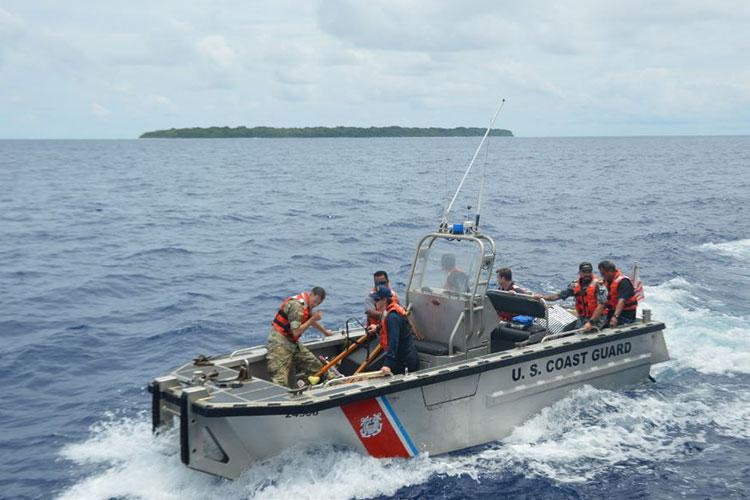 Crew members from the Coast Guard Cutter Sequoia (WLB 215) visit Sonsorol, Palau, to deliver food, fuel, and medicine from the Palau Ministry of Health, Oct. 22, 2020. Accompanying the Sequoia to Sonsorol was the Sonsorol State Governor Nicholas Aquino, Delegate Yutaka Gibbons, Jr., U.S. Ambassador John Hennessey-Niland, Lt. Cmdr. Clint Moore of the Royal Australian Navy, and Lt. Cmdr. Tommy Tomika of the Japan Coast Guard. (Photo by Courtesy)