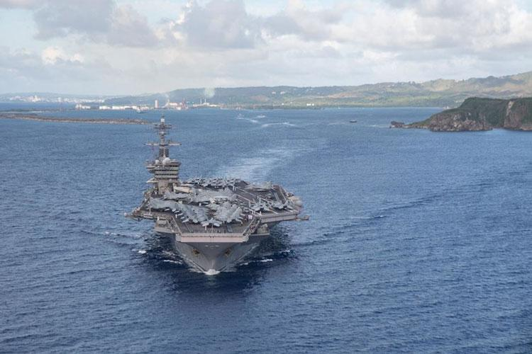 PHILIPPINE SEA (June 4, 2020) The aircraft carrier USS Theodore Roosevelt (CVN 71) departs Apra Harbor July 4, 2020. Following an extended visit to Guam in the midst of the COVID-19 global pandemic, Theodore Roosevelt is returning to operational tasking during a deployment to the Indo-Pacific. (Photo by Mass Communication Specialist Seaman Kaylianna Genier)