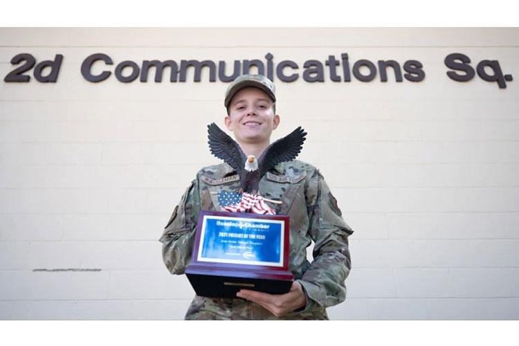 Senior Airman Mikhayla Waugaman, 2d Communications Squadron executive communications technician, poses for a photo with the 2021 Patriot of the Year trophy at Barksdale Air Force Base, Louisiana, Sept. 28, 2021. Waugaman was put up for the Patriot Award for her life-saving efforts on a Bomber Task Force deployment at the beginning of 2021 where she saved the life of a drowning snorkeler. (U.S. Air Force photo by Senior Airman Jovante Johnson)