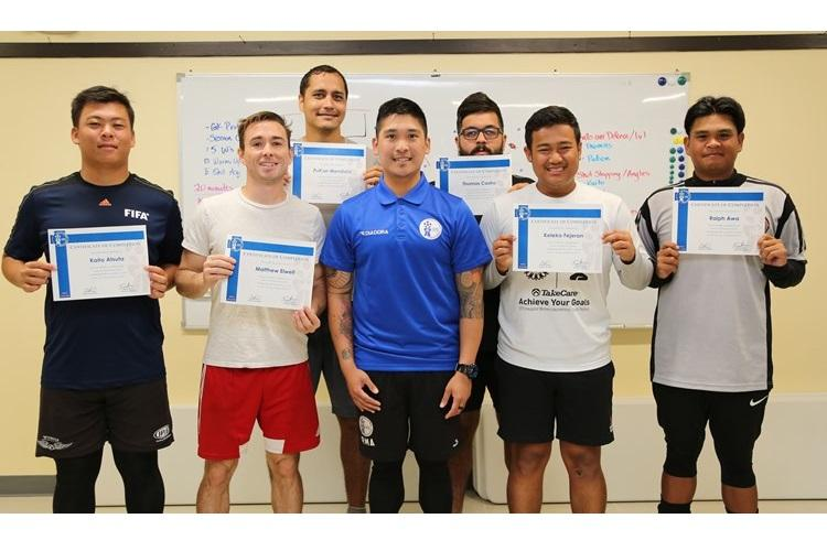 In front from left to right: Kaito Atsuta (Wings FC), Matthew Elwell (Bank of Guam Strykers FC), GFA Goalkeeper Coach Instructor & AFC-licensed Goalkeeper Coach Ross Awa, Keleko Fejeran (ASC Trust Islanders FC), and Ralph Awa (Wings FC). In the back, from left to right, are: Puti'on Mendiola (ASC Trust Islanders FC) and Thomas Castro (Wings FC).