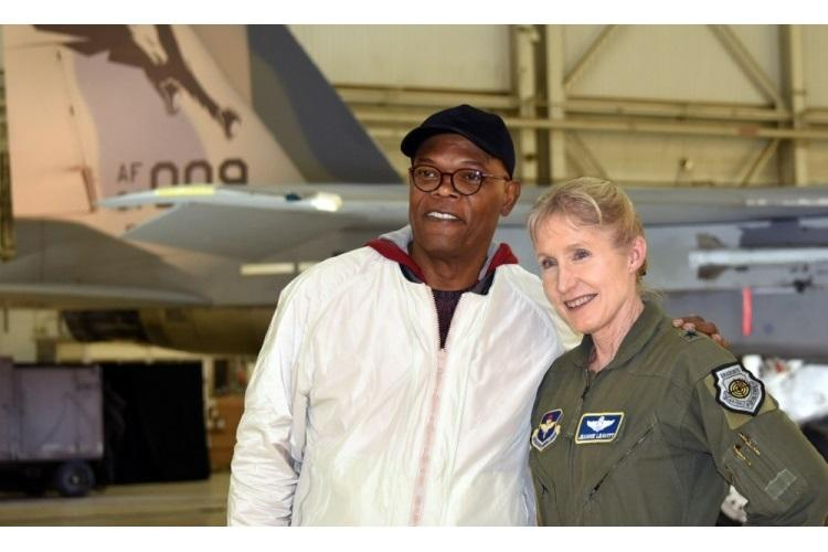"""Actor Samuel L. Jackson poses with Gen. Jeannie Leavitt after receiving a challenge coin from her during a media event for """"Captain Marvel"""" at Edwards Air Force Base, Calif., Feb. 20, 2019. Leavitt, the first Air Force female fighter pilot, was a consultant on the movie, and Jackson reprised his Nick Fury role. (DoD photo by Shannon Collins)"""