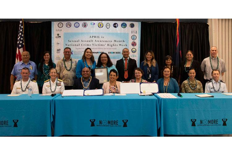 MANGILAO, Guam (April 8, 2019) - Guam local and military leadership gather for a photo following a joint proclamation signing declaring April as Sexual Assault Awareness and Prevention Month at the Guam Community College in Mangilao April 8. (U.S. Navy photo by JoAnna Delfin)