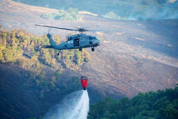 SANTA RITA, Guam (May 9, 2019) - Helicopter Sea Combat Squadron 25 drops water on a fire in Santa Rita May 9. Joint Region Marianas Fire and Emergency Services, the Guam Fire Department, the Department of Agriculture Forestry Division along with HSC-25 partnered to extinguish the blaze. (U.S. Navy photo by Kenji Yagi)
