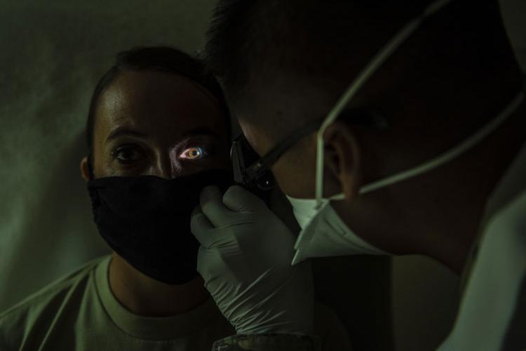 Capt. Everlino Ramos performs an eye exam on a patient at Andersen Air Force Base on May 16.