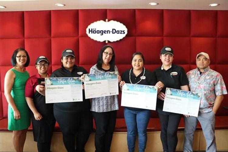 Guam Visitors Bureau Cultural Heritage Officer Dee Hernandez administered the Håfa Adai Pledge to the management team of Häagen-Dazs: General Manager, Elaine Dreckman, Häagen-Dazs Fiesta Resort Guam and Micronesia Mall Manager; Nicolette Mesa, Häagen-Dazs Guam Premier Outlet; JP Superstore Manager Ruben Mortera; and the employees of the Häagen-Dazs Fiesta Resort Guam location on June 17, 2019. (Photo courtesy of GVB.)